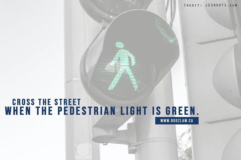 Cross the street when the pedestrian light is green.