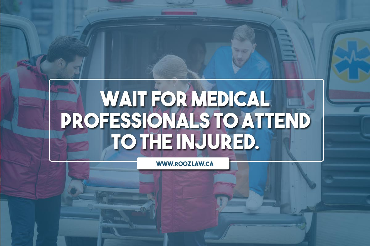 Wait for medical professionals to attend to the injured.